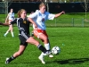 Sophomore Meghan Haun attempts to steal the ball away from SMW opponent on Apr. 12.