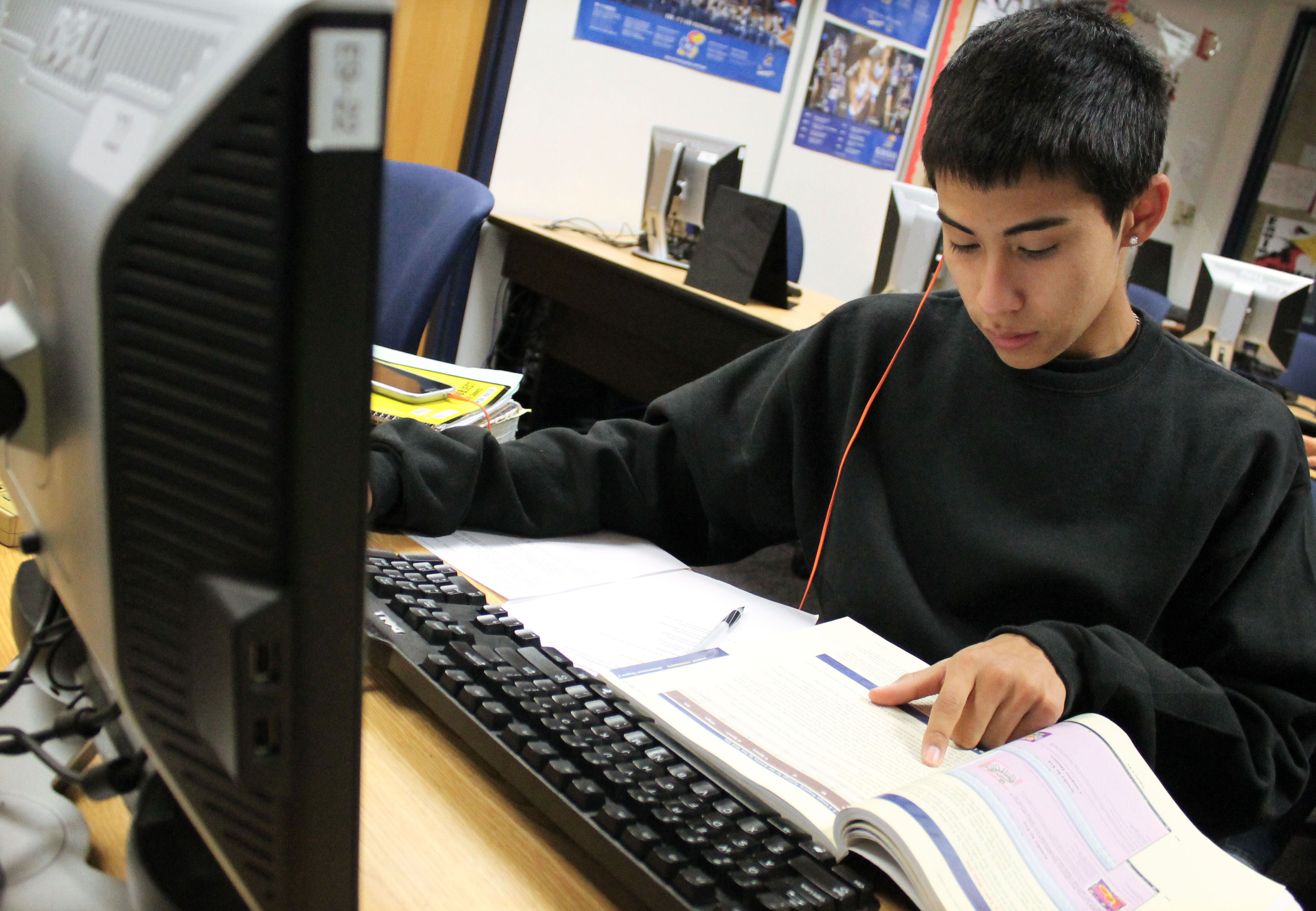 "1st Place—Academics, Jennifer Terrell, Maize. ""Sophomore Jon Nguyen works on desktop publishing assignments."""