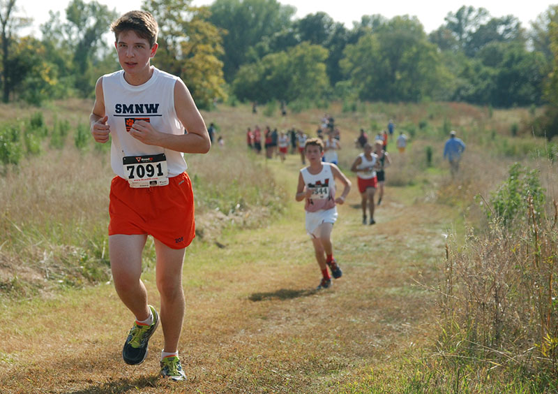 "Sophomore Jackson Brogan runs at the cross country meet at Shawnee Mission Park on Oct. 8. This is Brogan's second year in the SMNW cross country team. ""Cross country is all about dedication and persistence,"" Brogan said. ""There's not someone ready to sub in for you on the course—it's just all up to you."""