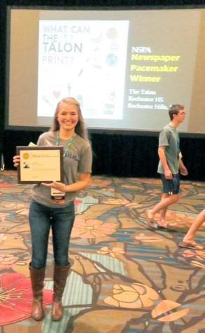 A staff member from The JagWire from Mill Valley High School earns a Pacemaker award for newspaper at the Orlando NSPA/JEA convention November 14, 2015.