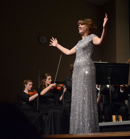 Singing a solo for the Master Works concert, senior Rose Smithson shows off her voice. Smithson had to learn an entire song in Italian to preform that night. phot by: Max Ramsay